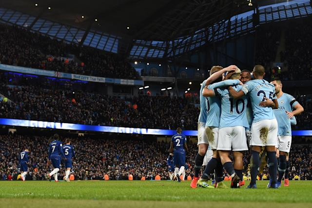 Drubbing: City celebrate after hitting Chelsea for six (AFP/Getty Images)