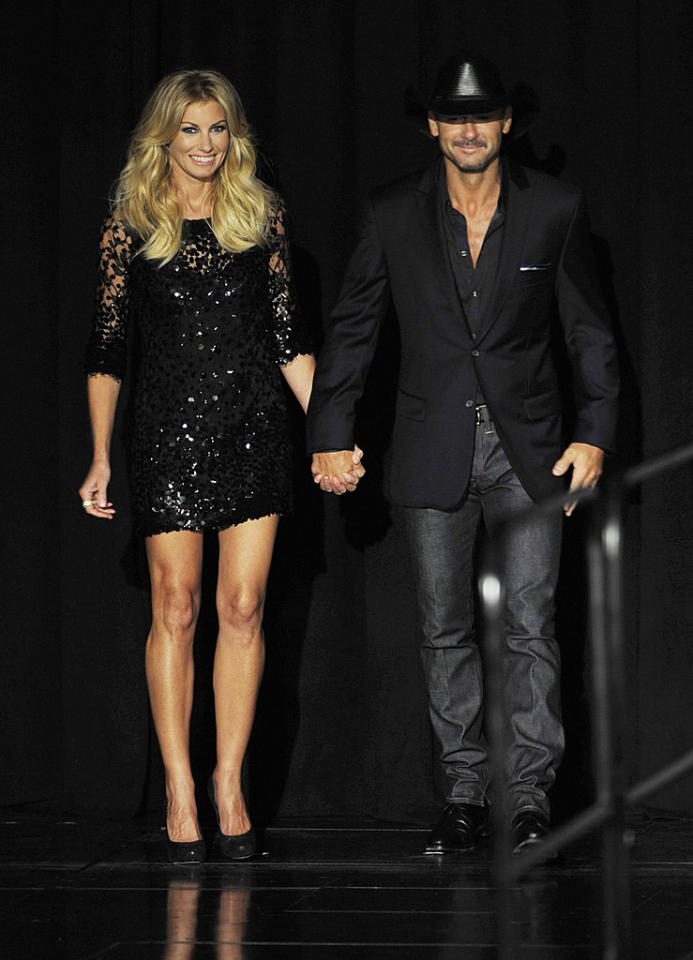 """Speaking of sexy singers, check out Nashville's most dynamic duo, Faith Hill and Tim McGraw, who also made a big announcement this week. On Tuesday morning, the husband and wife unveiled their <a target=""""_blank"""" href=""""http://omg.yahoo.com/news/tim-mcgraw-faith-hill-announce-las-vegas-shows-180318595.html"""">""""Soul2Soul"""" concert residency</a> during a press conference at Sin City's Venetian luxury hotel and casino resort. Dressed in a sequined frock, Faith looked fab next to her country-crooning hubby, who opted for a blazer and button-down, along with his signature cowboy hat. (8/7/2012)"""