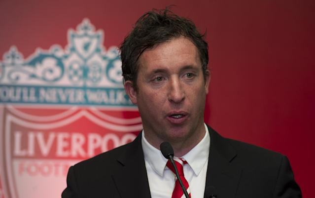 Former Liverpool Football Club and England striker Robbie Fowler speaks to media at an event in New Delhi on January 6, 2014 (AFP Photo/Sajjad Hussain)