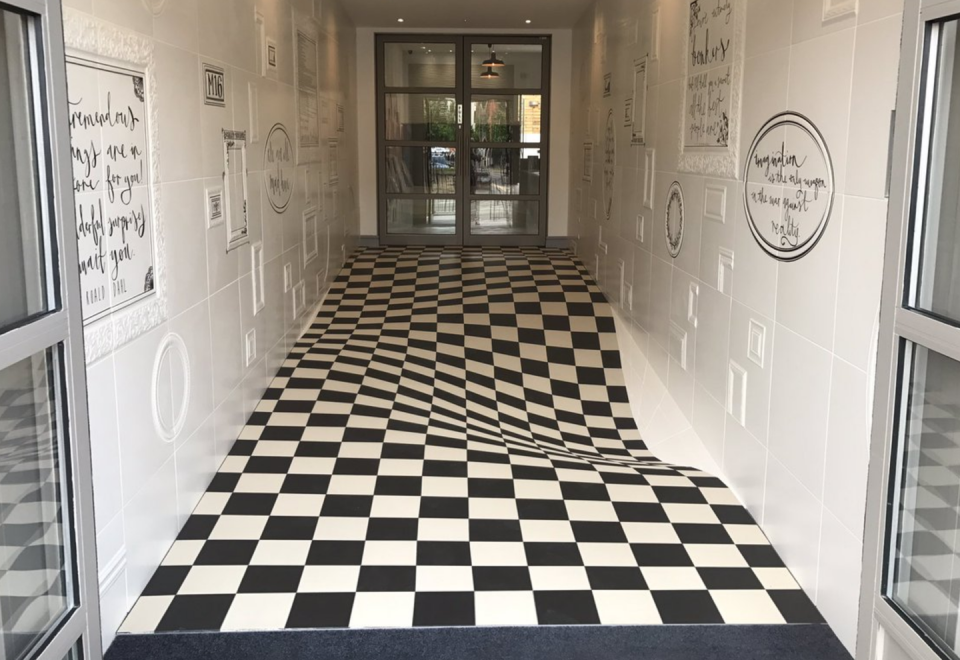 "<p>This <a href=""https://www.popularmechanics.com/science/news/a28572/tile-floor-optical-illusion/"" rel=""nofollow noopener"" target=""_blank"" data-ylk=""slk:waving tile floor"" class=""link rapid-noclick-resp"">waving tile floor</a> is the result of careful tile cutting, creating an illusion of forced perspective. For people in older apartment buildings, this could just look like a bad maintenance day.</p>"