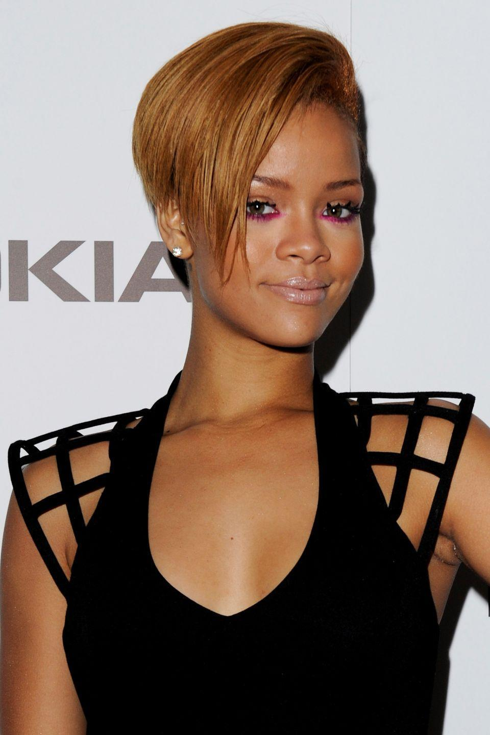 <p>Rihanna wears her strawberry blonde pixie cut straight and layered. </p>