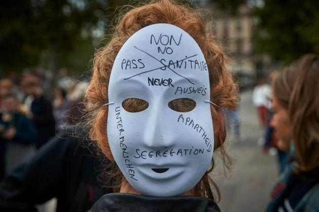 PARIS, FRANCE - JULY 14: Anti-Vaccine protestors gather at Place de la Republique in protest against the new restrictions announced by President Macron on Monday claiming the new measures are a form of apartheid on July 14, 2021 in Paris, France. Starting August 1, people will have to show proof of vaccination or a negative Covid-19 test to access bars, cafes, restaurants, shopping centres, hospitals, long-distance trains and planes. A similar rule will apply to large events from July 21. (Photo by Kiran Ridley/Getty Images) (Photo: Kiran Ridley via Getty Images)