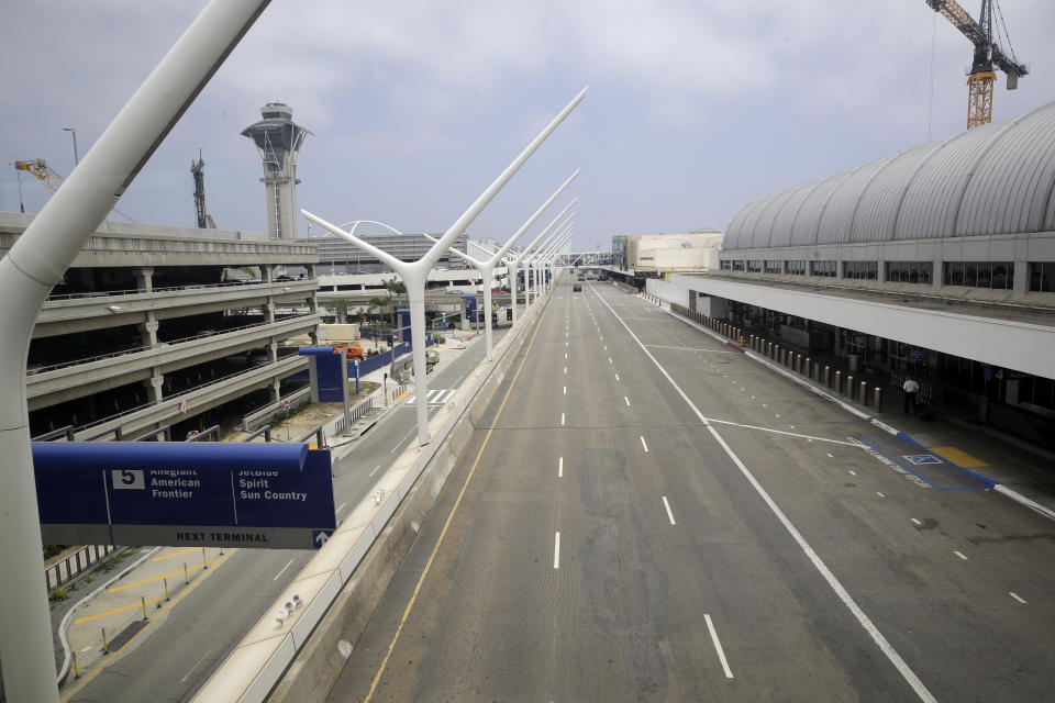 A empty street is seen at the Los Angeles International Airport Thursday, May 28, 2020, in Los Angeles. From Britain's EasyJet to American and Delta in the U.S., airlines are cutting even more jobs to cope with a crushing drop in air travel caused by the coronavirus. (AP Photo/Marcio Jose Sanchez)