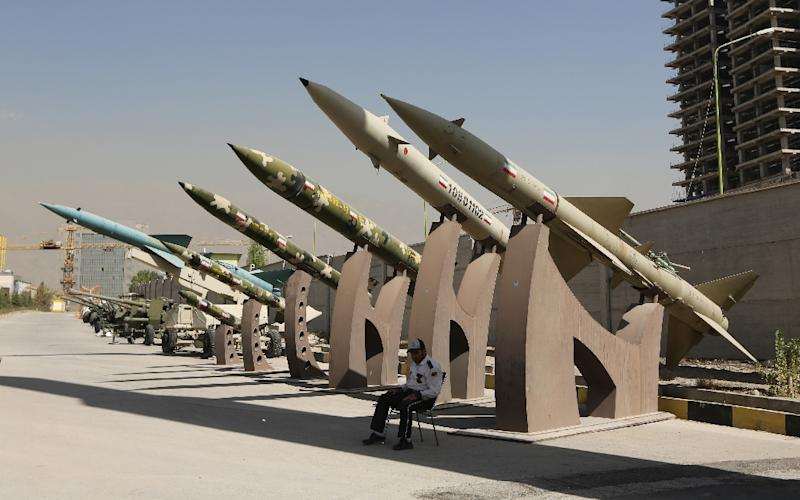 Iranian missiles are displayed at a park in northern Tehran (AFP Photo/Atta Kenare)