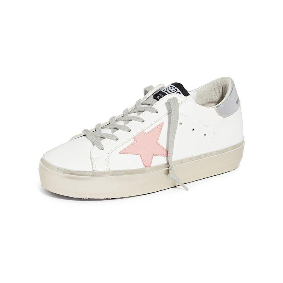 """<p><strong>Golden Goose </strong></p><p>shopbop.com</p><p><a href=""""https://go.redirectingat.com?id=74968X1596630&url=https%3A%2F%2Fwww.shopbop.com%2Fstar-sneaker-golden-goose%2Fvp%2Fv%3D1%2F1505353181.htm&sref=https%3A%2F%2Fwww.elle.com%2Ffashion%2Fshopping%2Fg36080635%2Fshopbop-spring-sale%2F"""" rel=""""nofollow noopener"""" target=""""_blank"""" data-ylk=""""slk:Shop Now"""" class=""""link rapid-noclick-resp"""">Shop Now</a></p><p><strong><del>$560</del> $448 (20% off)</strong></p><p>Golden Goose sneakers can seldom be found on sale, let alone for $112 off. If you've long coveted a pair, Shopbop currently has <a href=""""https://go.redirectingat.com?id=74968X1596630&url=https%3A%2F%2Fwww.shopbop.com%2Fgolden-goose-shoes-sneakers%2Fbr%2Fv%3D1%2F30962.htm&sref=https%3A%2F%2Fwww.elle.com%2Ffashion%2Fshopping%2Fg36080635%2Fshopbop-spring-sale%2F"""" rel=""""nofollow noopener"""" target=""""_blank"""" data-ylk=""""slk:over 70 different styles"""" class=""""link rapid-noclick-resp"""">over 70 different styles</a> in stock.</p>"""