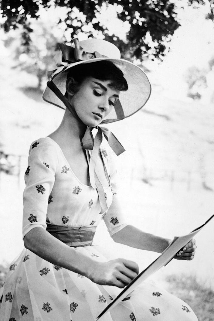 <p> While in character filming the movie <em>War and Peace </em>in 1956, Audrey Hepburn sketches on a notepad. The actress starred alongside her husband, Mel Ferrer.</p>