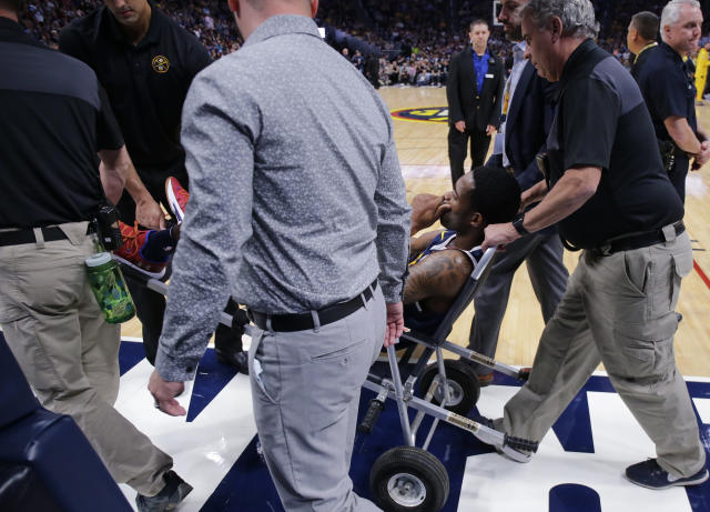 "<a class=""link rapid-noclick-resp"" href=""/nba/players/5074/"" data-ylk=""slk:Will Barton"">Will Barton</a> is carted off the court after being injured during the third quarter against the <a class=""link rapid-noclick-resp"" href=""/nba/teams/pho"" data-ylk=""slk:Suns"">Suns</a> on Saturday night. (AP)"