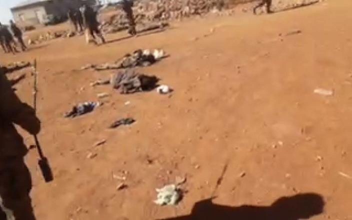 Ethiopian soldiers walk among the bodies of dozens of recently-killed Tigrayan villagers in Debre Abay monastery. The full footage is too graphic to publish. - The Telegraph / screengrab