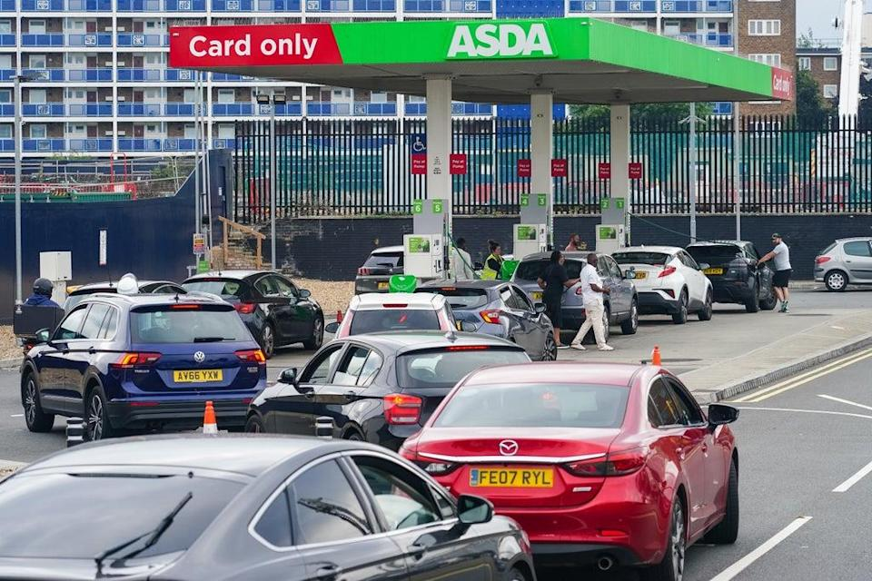 Cars queue for fuel at an Asda petrol station in south London (Dominic Lipinski/PA) (PA Wire)