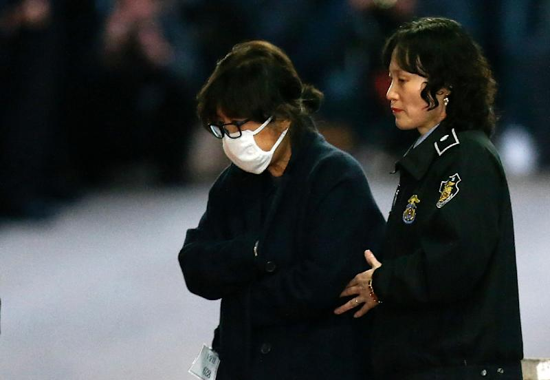 Choi Soon-Sil (L), a secretive, long-time confidante of Park Geun-Hye, stands accused of meddling in state affairs, squeezing tens of millions of dollars from local companies and amassing a fortune by leveraging her ties to the president (AFP Photo/)