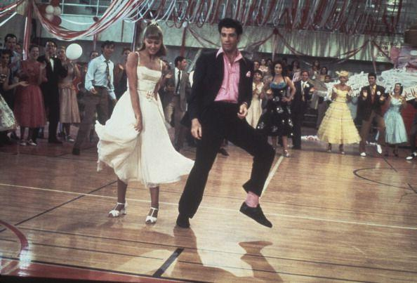 "<p>Danny may have looked sharp, but he was no match for Sandy, who looked as sweet as can be in this short dress. The couple's dance moves, however, were the real winner that night.</p><p><strong>RELATED: </strong><a href=""https://www.goodhousekeeping.com/life/entertainment/g3193/grease-facts/"" rel=""nofollow noopener"" target=""_blank"" data-ylk=""slk:26 Things You Didn't Know About &quot;Grease&quot;"" class=""link rapid-noclick-resp"">26 Things You Didn't Know About ""Grease""</a></p><p><a class=""link rapid-noclick-resp"" href=""https://www.amazon.com/Grease-Randal-Kleiser/dp/B001CTGQBK?tag=syn-yahoo-20&ascsubtag=%5Bartid%7C10063.g.36197518%5Bsrc%7Cyahoo-us"" rel=""nofollow noopener"" target=""_blank"" data-ylk=""slk:STREAM NOW"">STREAM NOW</a></p>"