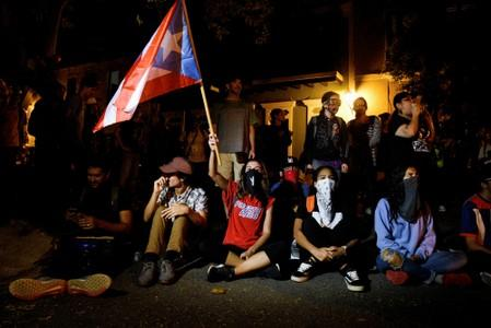 Demonstrators sit-in to block the exit of Pedro Pierluisi's convoy after his first news conference as Governor of Puerto Rico in San Juan