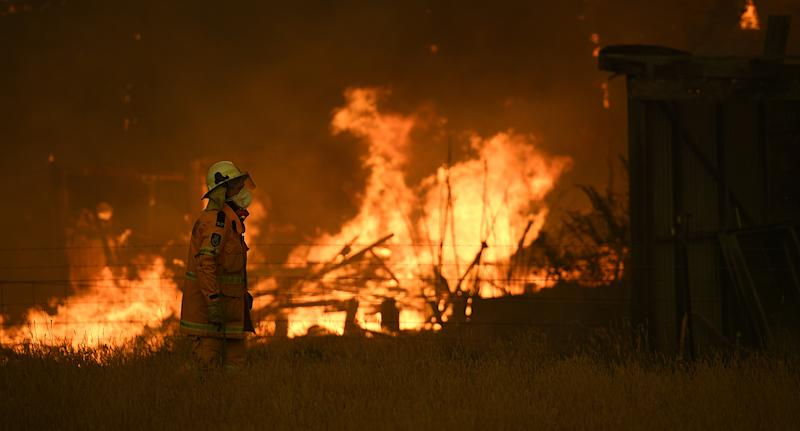 NSW Rural Fire Service crews fight the Gospers Mountain Fire as it impacts a property at Bilpin, Saturday.