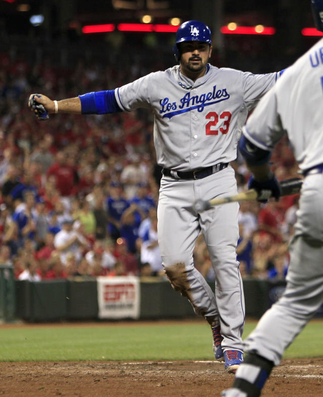 Los Angeles Dodgers' Adrian Gonzalez scores at home after Hanley Ramirez double hit off Cincinnati Reds pitcher Homer Bailey in the fourth inning during a baseball game, Sunday, Sept. 8, 2013, in Cincinnati. (AP Photo/David Kohl)