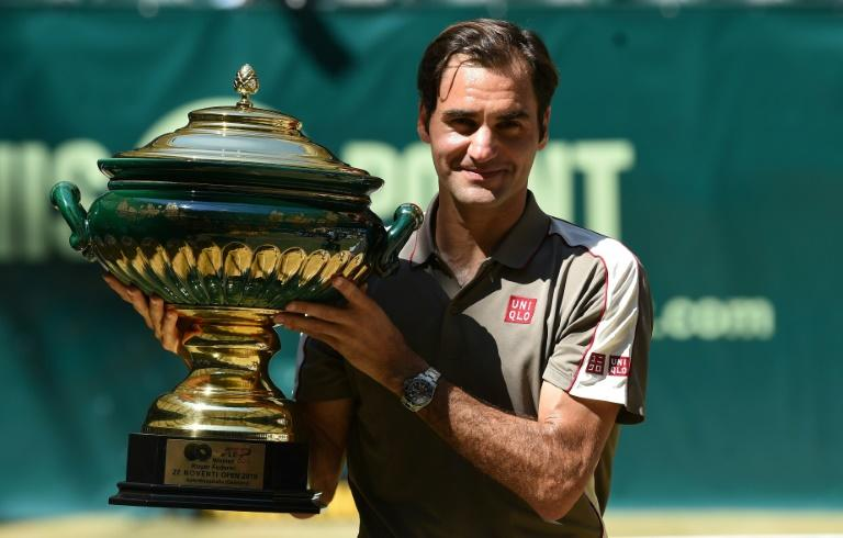 Prize guy: Roger Federer poses with the Halle trophy last weekend