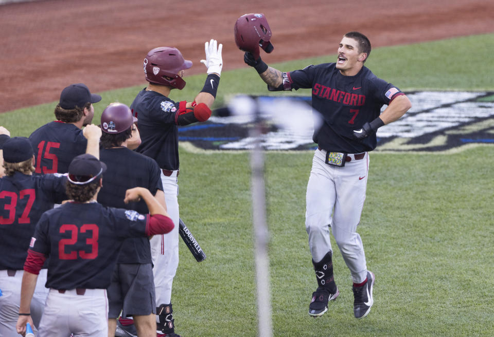 Stanford's Brock Jones (7), right, celebrates with teammates after hitting a home run against Vanderbilt in the third inning during a baseball game in the College World Series Wednesday, June 23, 2021, at TD Ameritrade Park in Omaha, Neb. (AP Photo/Rebecca S. Gratz)