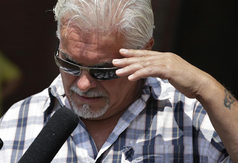 """Steve Davis speaks to reporters about his sister, alleged murder victim Debra Davis, outside U.S. District Court in Boston, Monday, July 22, 2013, after the session of James """"Whitey"""" Bulger's murder and racketeering trial ended for the day. Davis exploded in anger in court after Bulger's former partner Stephen """"The Rifleman"""" Flemmi identified him as a drug user and informant. Davis jumped up and shouted across the courtroom, and Flemmi quickly tried to correct himself, saying he meant to identify another Davis brother. Flemmi also apologized. (AP Photo/Steven Senne)"""
