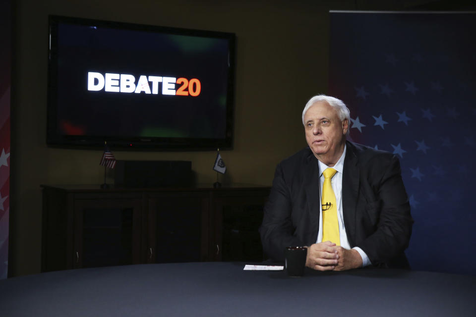 FILE - West Virginia Gov. Jim Justice prepares for a debate with Democratic challenger, Kanawha County Commissioner Ben Salango, Tuesday Oct. 13. 2020, in Morgantown, W.Va. Justice announced on Friday, Nov. 13, a mandatory face covering requirement indoors at businesses and all other spaces will take effect at midnight. Justice said businesses will need to post mask requirements at establishments under the rules of his executive order. (AP Photo/Kathy Batten, File)