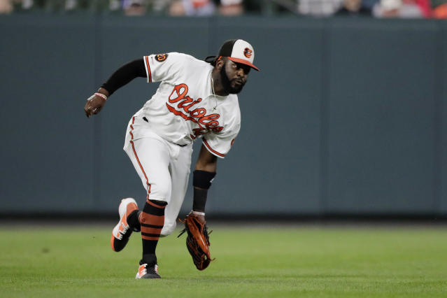 Baltimore Orioles left fielder Dwight Smith Jr. fields a single by Toronto Blue Jays' Bo Bichette during the second inning of a baseball game, Wednesday, Sept. 18, 2019, in Baltimore. Blue Jays' Rowdy Tellez scored on the play. (AP Photo/Julio Cortez)