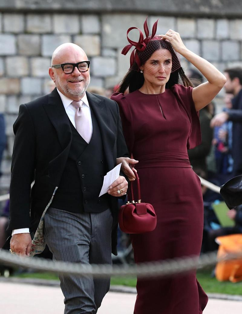 Demi Moore arrives in a maroon dress (PA Wire/PA Images)