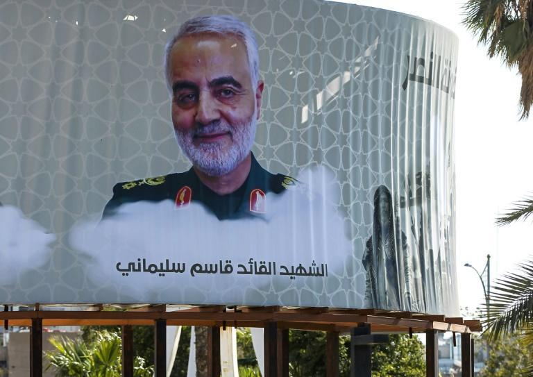 """A billboard in Baghdad's Karrada district mourns Iranian General Qassem Soleimani, describing him as a """"martyr"""" after he was killed by US forces (AFP Photo/AHMAD AL-RUBAYE)"""