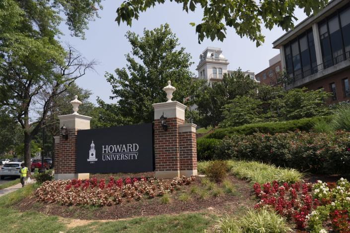FILE - In this July 6, 2021, file photo, an electronic signboard welcomes people to the Howard University campus in Washington. With the surprise twin hiring of two of the country's most prominent writers on race, Howard University is positioning itself as one of the primary centers of Black academic thought just as America struggles through a painful crossroads over historic racial injustice. (AP Photo/Jacquelyn Martin, File)