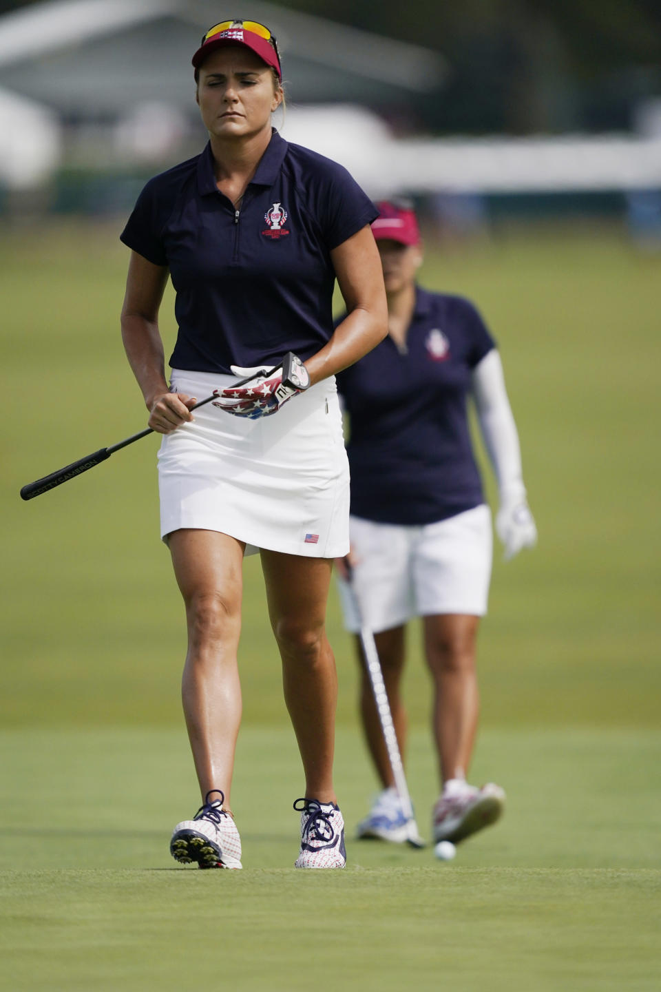 Lexi Thompson walks to the 14th green during practice for the Solheim Cup golf tournament, Friday, Sept. 3, 2021, in Toledo, Ohio. (AP Photo/Carlos Osorio)