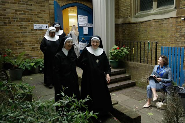 <p>Benedictine nuns from Tyburn Convent leave after voting in Britain's general election at a polling station in St John's Parish Hall, London, Thursday, June 8, 2017. (Photo: Matt Dunham/AP) </p>