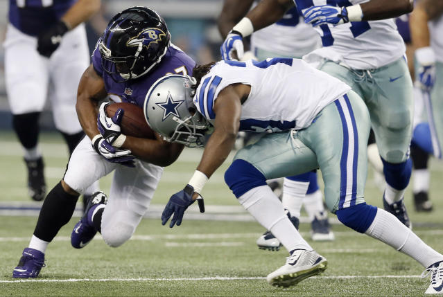 Baltimore Ravens running back Ray Rice, left, collides with Dallas Cowboys strong safety J.J. Wilcox during the first half of an NFL preseason football game Saturday, Aug. 16, 2014, in Arlington, Texas. (AP Photo/Brandon Wade)