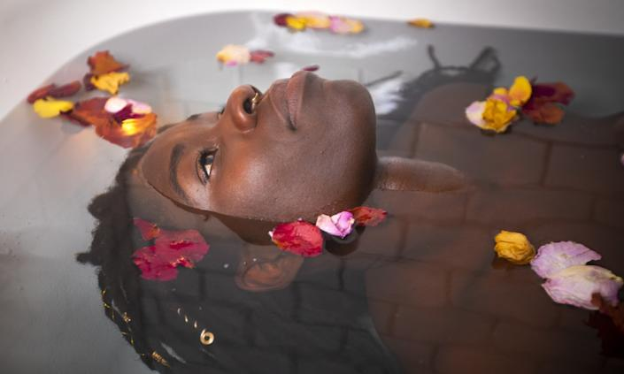 """Alua Arthur soaks in her bath ritual, which includes rose petals, Epsom salt and scented candles, to help deal with the stress of an emotional job. <span class=""""copyright"""">(Francine Orr / Los Angeles Times)</span>"""