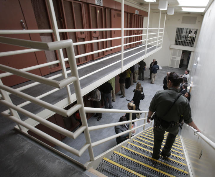 FILE -- In this Aug. 17, 2011 file photo, reporters inspect one of the two-tiered cell pods in the Secure Housing Unit at the Pelican Bay State Prison near Crescent City, Calif. California prison officials with the backing of a federal health care receiver are seeking court permission to force-feed inmates who have been participating in a hunger strike that is entering its seventh week. (AP Photo/Rich Pedroncelli, file)