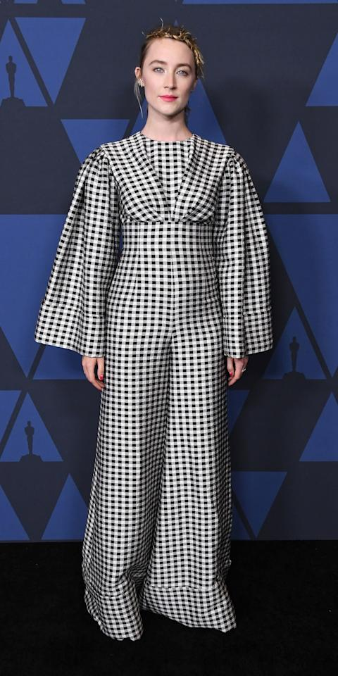 <p>Some went with gowns for the 2019 Governors Awards, but Saoirse made quite the statement in a gingham Emilia Wickstead jumpsuit, Giuseppe Zanotti heels, and Ana Khouri jewelry.</p>
