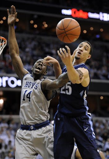 Georgetown center Henry Sims (14) battles for the ball against Villanova's Maurice Sutton (25) during the first half of an NCAA college basketball game, Saturday, Feb. 25, 2012, in Washington. (AP Photo/Nick Wass)