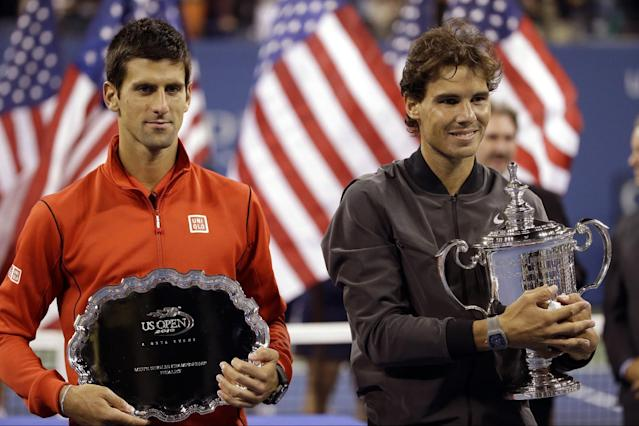 Novak Djokovic, of Serbia, and Rafael Nadal, of Spain, pose for photos after Nadal won the men's singles final of the 2013 U.S. Open tennis tournament, Monday, Sept. 9, 2013, in New York. (AP Photo/David Goldman)