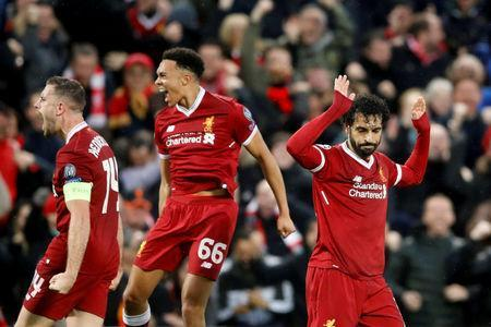 Soccer Football - Champions League Semi Final First Leg - Liverpool vs AS Roma - Anfield, Liverpool, Britain - April 24, 2018 Liverpool's Mohamed Salah celebrates scoring their first goal with team mates Action Images via Reuters/Carl Recine