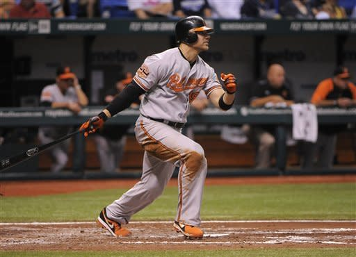 Baltimore Orioles' Chris Davis follows through as he hits a two-run single to right center field to score teammates Mark Reynolds and Nick Markakis during the fourth inning of a baseball game against the Tampa Bay Rays, Saturday, Aug. 4, 2012, in St. Petersburg, Fla. (AP Photo/Brian Blanco)