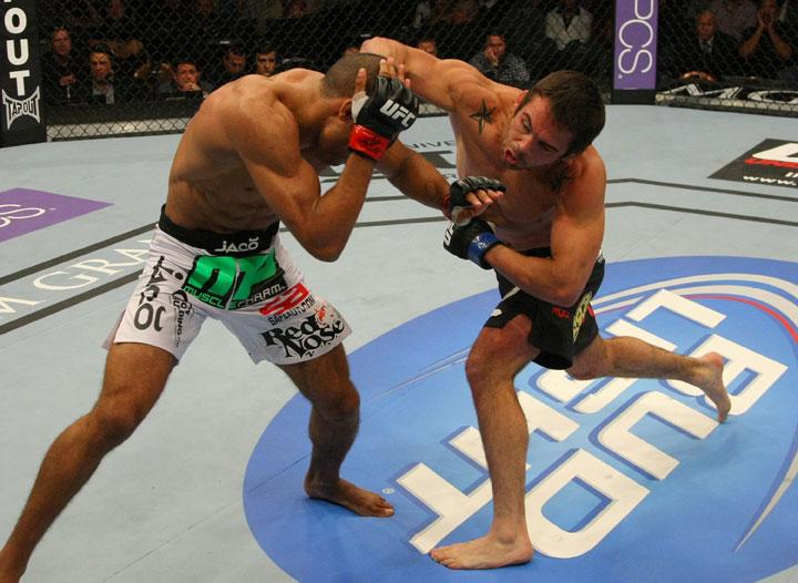 LAS VEGAS, NV - MAY 26:  Jamie Varner (R) punches Edson Barboza during a lightweight bout at UFC 146 at MGM Grand Garden Arena on May 26, 2012 in Las Vegas, Nevada.