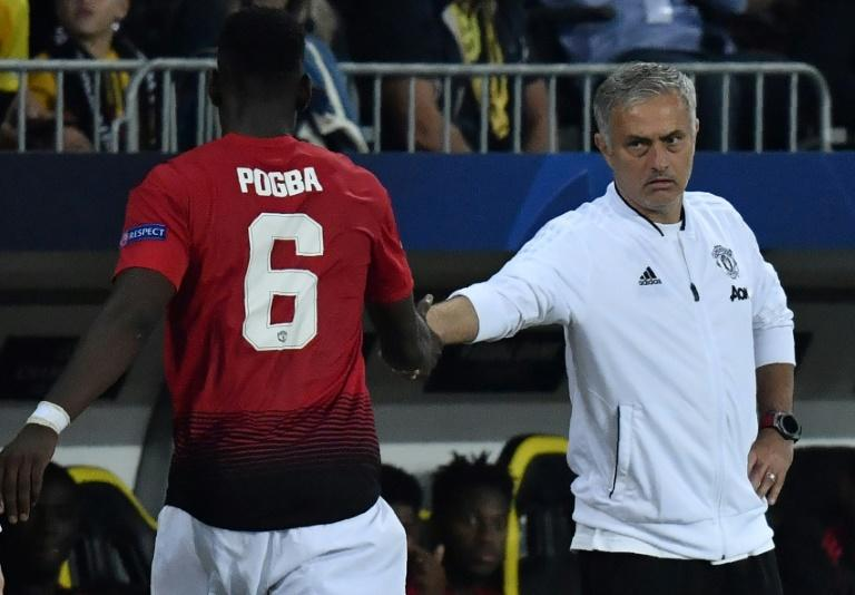 Paul Pogba (left) and Jose Mourinho are at loggerheads at Manchester United
