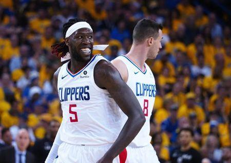 Apr 24, 2019; Oakland, CA, USA; LA Clippers forward Montrezl Harrell (5) celebrates after a play against the Golden State Warriors during the fourth quarter in game five of the first round of the 2019 NBA Playoffs at Oracle Arena. Mandatory Credit: Kelley L Cox-USA TODAY Sports