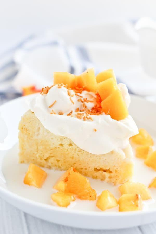 """<p>Milky tres leches cake + sweet peaches and cream = a perfect match made in heaven. <br></p><p><em><a href=""""https://tidbits-marci.com/instant-pot-tres-leches-cake/"""" rel=""""nofollow noopener"""" target=""""_blank"""" data-ylk=""""slk:Get the recipe from Tidbits »"""" class=""""link rapid-noclick-resp"""">Get the recipe from Tidbits »</a></em></p>"""