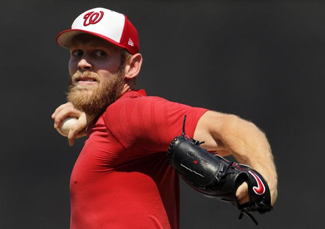 <p>FILE – In this Aug. 9, 2017, file photo, Washington Nationals pitcher Stephen Strasburg throws from the mound during a simulated baseball game, at Nationals Park in Washington. Strasburg has been on the disabled list with a nerve impingement in his right elbow since July 27, 2017. (AP Photo/Carolyn Kaster, File) </p>