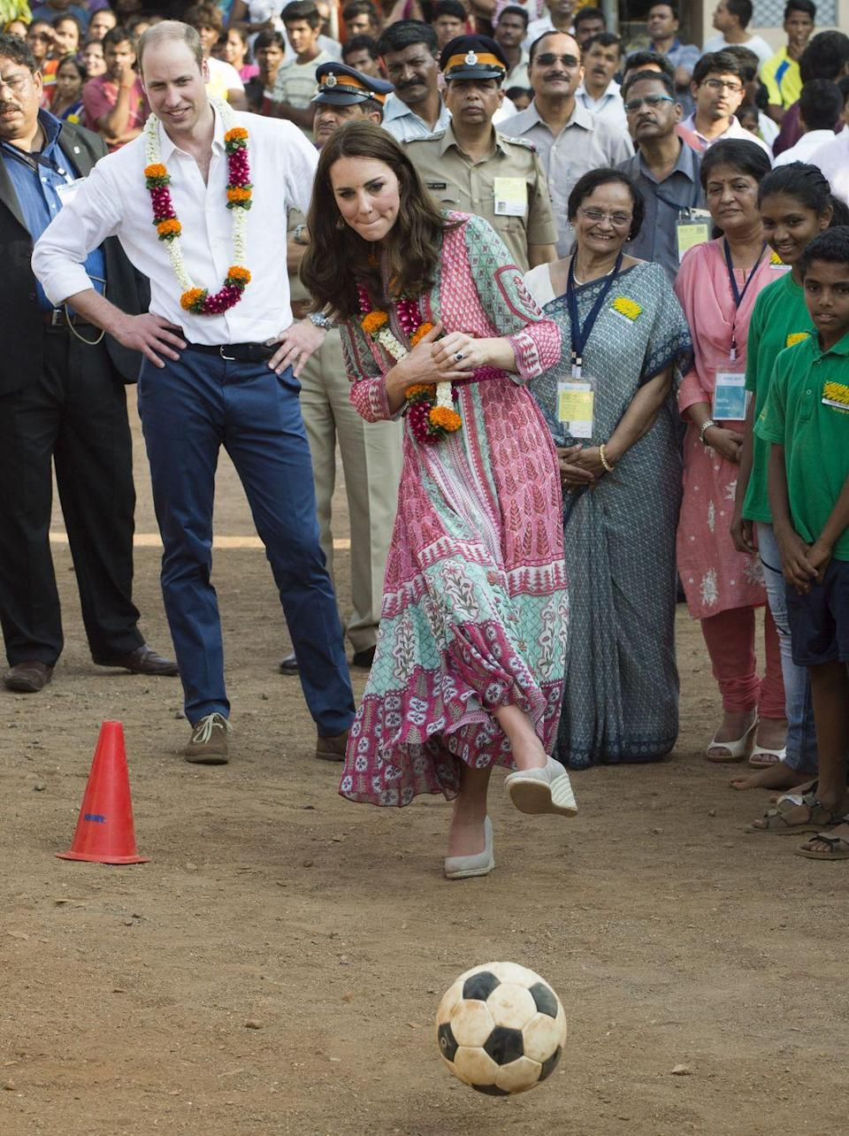 <p>While not exactly wearing proper sporting attire, Kate did not hesitate to join a soccer game on her royal visit to India.</p>