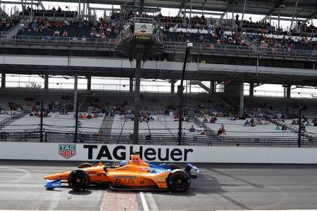 FILE PHOTO: May 19, 2019; Indianapolis, IN, USA; NTT IndyCar series driver Fernando Alonso (66) on his qualifying run fails to qualify for the 103rd Running of the Indianapolis 500 at Indianapolis Motor Speedway. Mandatory Credit: Brian Spurlock-USA TODAY Sports
