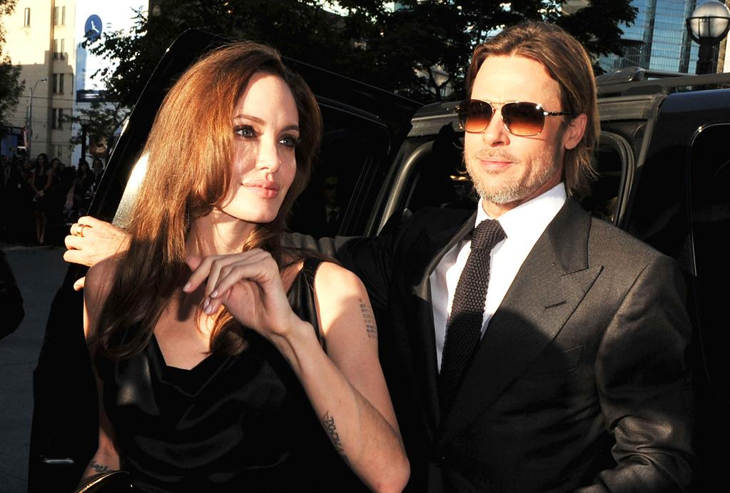 "Angelina Jolie and Brad Pitt at the 2011 Toronto Film Festival premiere of ""Moneyball"" on September 9, 2011."