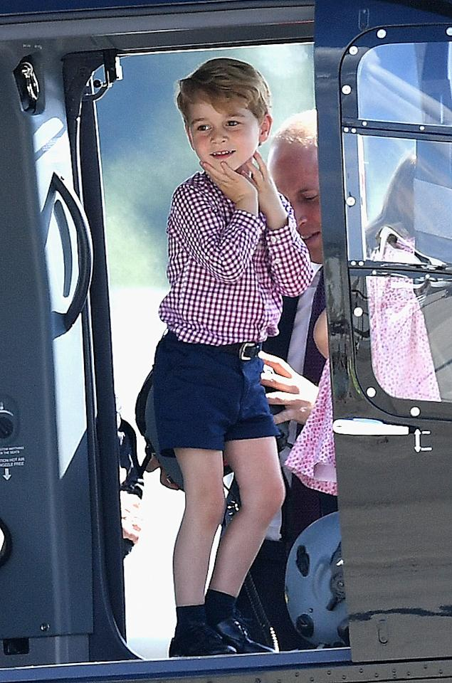 <p><b><b><b>It wasn't just Charlotte that was allowed a sneak peek inside a helicopter – Prince George also got his turn. <br /><em>[Photo: PA]</em> </b></b></b></p>