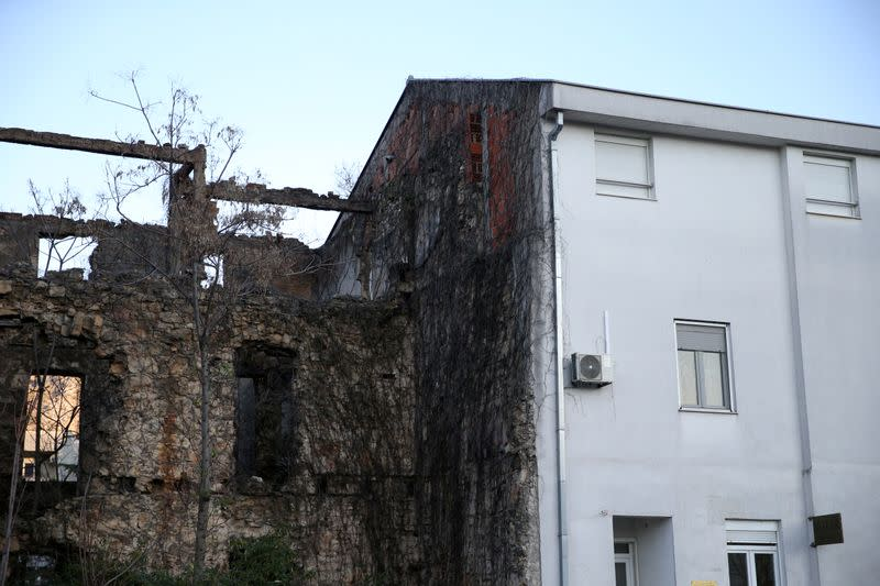 A building that was destroyed during the 1992-1995 war in Bosnia is seen half renovated in Mostar