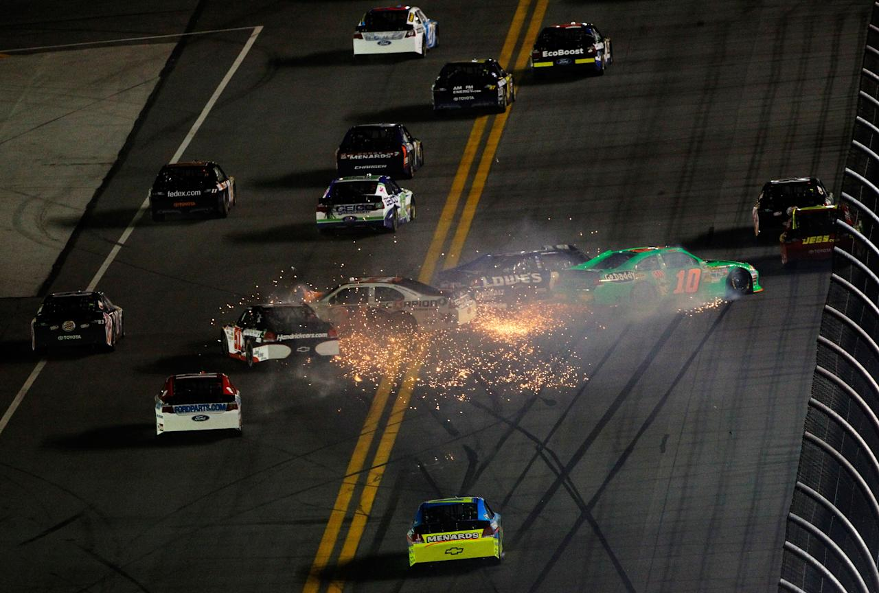 DAYTONA BEACH, FL - FEBRUARY 27:  Danica Patrick, driver of the #10 GoDaddy.com Chevrolet, Jimmie Johnson, driver of the #48 Lowe's Chevrolet, David Ragan, driver of the #34 Front Row Motorsports Ford, and Kurt Busch, driver of the #51 Tag Heuer Avant-Garde Chevrolet Chevrolet, spin after an on track incident in the NASCAR Sprint Cup Series Daytona 500 at Daytona International Speedway on February 27, 2012 in Daytona Beach, Florida.  (Photo by Tom Pennington/Getty Images for NASCAR)