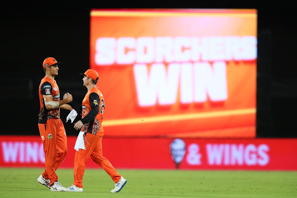 Aaron Hardie of the Scorchers and Colin Munro of the Scorchers celebrate victory during the Big Bash League 'Challenger Final' match between the Perth Scorchers and Brisbane Heat.