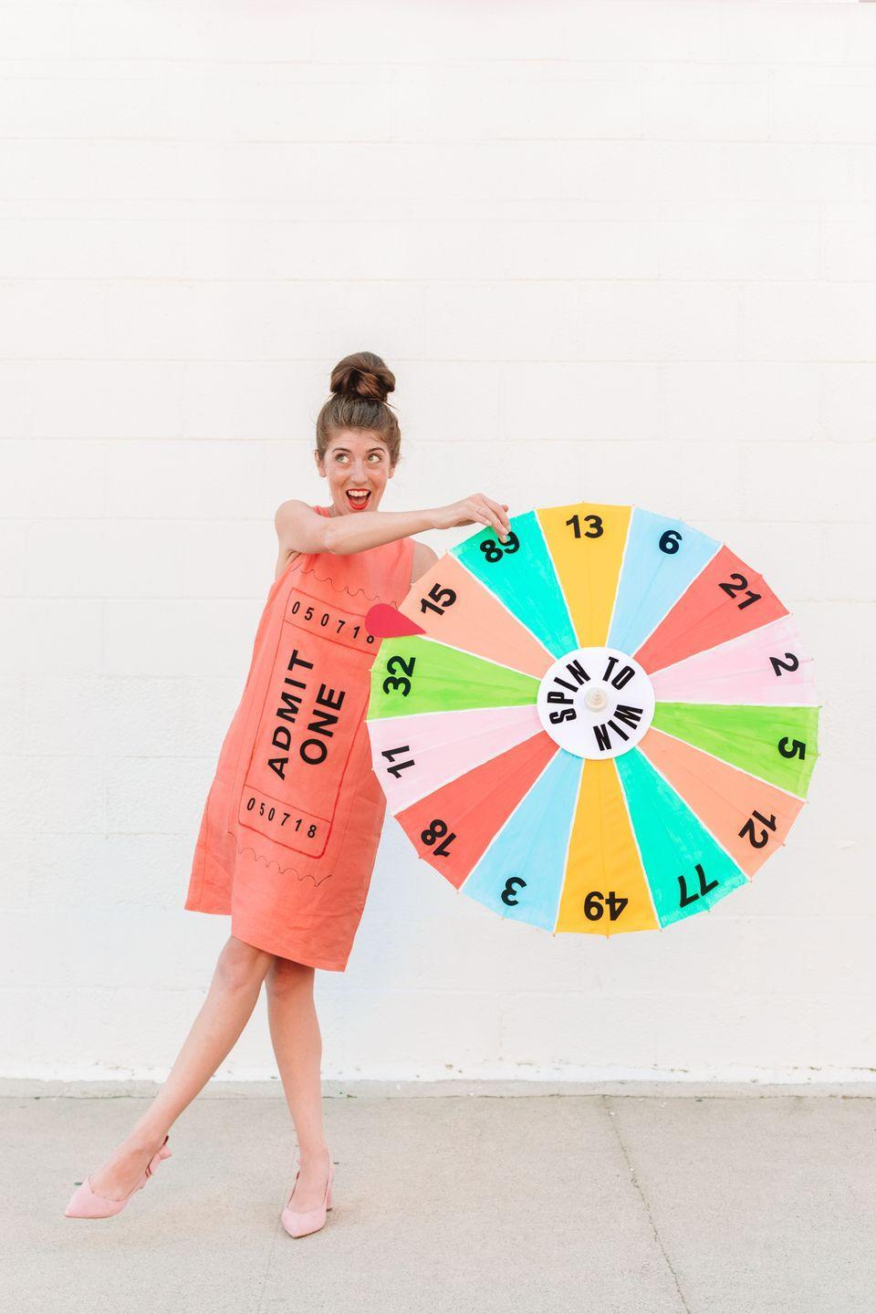 """<p>This ingenious costume uses a parasol to make the carnival game, but you'll be the real winner decked out in it.</p><p><strong>Get the tutorial at <a href=""""https://studiodiy.com/diy-carnival-game-costume/"""" rel=""""nofollow noopener"""" target=""""_blank"""" data-ylk=""""slk:Studio DIY"""" class=""""link rapid-noclick-resp"""">Studio DIY</a>.</strong></p><p><strong><a class=""""link rapid-noclick-resp"""" href=""""https://www.amazon.com/gp/product/B00RKBS9A0/ref=as_li_ss_tl?tag=syn-yahoo-20&ascsubtag=%5Bartid%7C10050.g.4571%5Bsrc%7Cyahoo-us"""" rel=""""nofollow noopener"""" target=""""_blank"""" data-ylk=""""slk:SHOP WHITE PARASOLS"""">SHOP WHITE PARASOLS</a><br></strong></p>"""