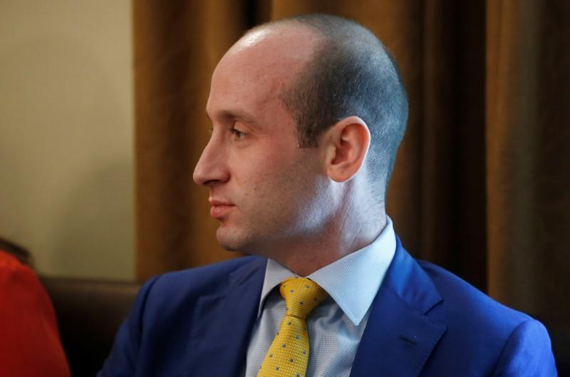 FILE PHOTO:  White House adviser Stephen Miller listens as U.S. President Trump holds cabinet meeting at the White House in Washington